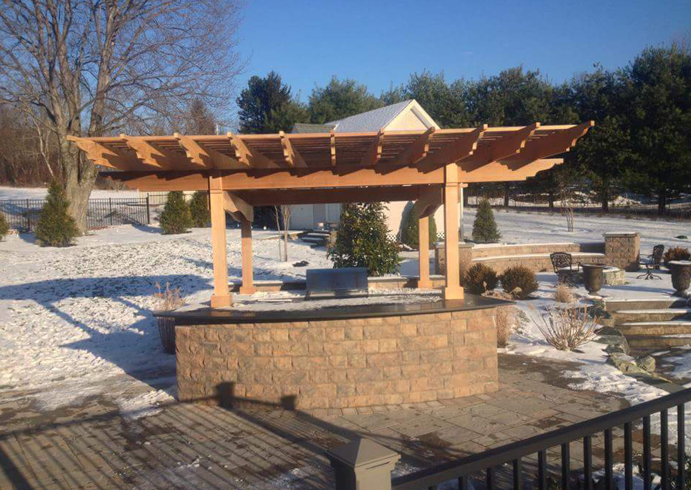 custom outdoor kitchen with pergola