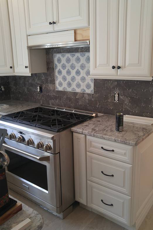 kitchen remodeling project with new cabinetry and granite countertop